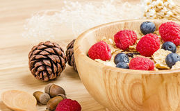 Bowl of cereals with raspberries and blueberrys on a wooden Stock Photo