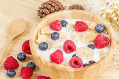Bowl of cereals with raspberries and blueberrys on a wooden Stock Photography