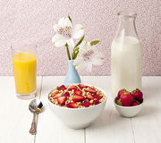 Bowl of cereals with strawberry juice and milk Stock Photo