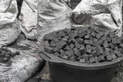 Bowl of charcoal cubes for hookah Stock Image