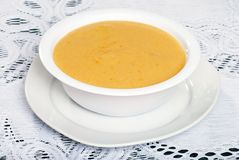 Bowl of cheddar cheese soup Stock Images