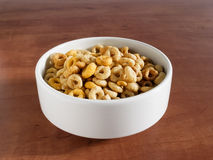 Bowl with cheerios. Whole grain cereals on a table Royalty Free Stock Image