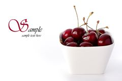 Bowl of cherries. Bowl of tasty cherries, isolated on a white background stock images