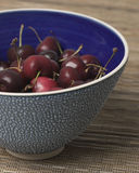 Bowl of Cherries. Blue bowl filled with Cherries Stock Photo
