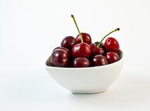 Bowl of cherries. On a white background Stock Photography