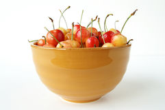 Bowl of cherries. A still life of a bowl full of ripe yellow cherries stock photos