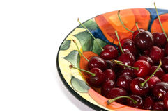 Bowl of Cherries. Bowl of fresh cherries with water droplets on white background Stock Photography