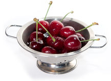 Bowl of Cherries. Bowl of fresh cherries with water droplets on white background Stock Photo