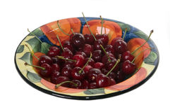 Bowl of Cherries. Bowl of fresh cherries with water droplets on white background Royalty Free Stock Photo