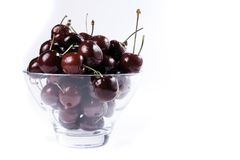 Bowl of cherries. Red cherries in glass bowl against white background Stock Photos