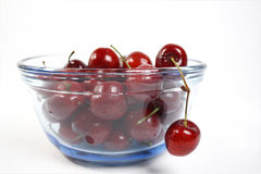 Bowl of cherries. Glass bowl filled with cherrries royalty free stock photo