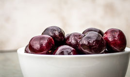 Bowl of Cherries. Bowl of large, plump, juicy, succulent, tasty ripe cherries. Delicious Stock Photos