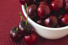 Bowl Of Cherries. A bowl of red cherries with focus on the cherries in the bowl Stock Photography