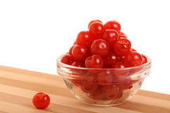 Bowl of cherries. Transparent bowl with cherries on a bamboo table Royalty Free Stock Images