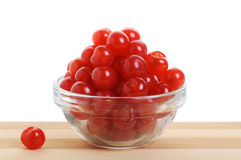 Bowl of cherries. Transparent bowl with cherries on a bamboo table. Horizontal design with separate underlying berry Stock Images