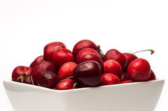 Bowl of Cherries. On white background stock photos