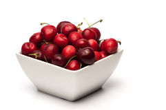 Bowl of Cherries. On white background royalty free stock photography