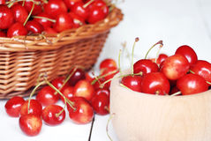 Bowl with cherries on the white wooden table Stock Photo