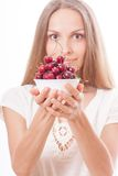 Bowl of cherries in women's hands Stock Images