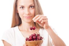 Bowl of cherries in women's hands Stock Photos