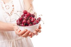 Bowl of cherries in women's hands Royalty Free Stock Photography