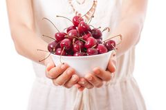 Bowl of cherries in women's hands Royalty Free Stock Photos
