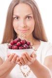 Bowl of cherries in women's hands Stock Photo