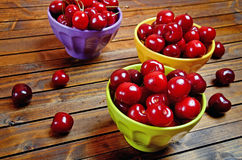 Bowl with cherries on wooden table Royalty Free Stock Photography