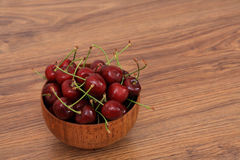 A bowl of cherries. On the wooden table, healthy snack stock photo