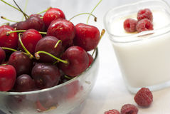 A bowl of cherries and yogurt with raspberry Stock Image