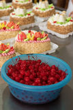 Bowl of cherry on cake production Stock Photos