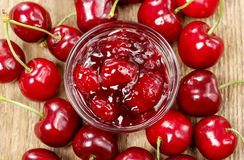 Bowl of cherry jam on wooden table Royalty Free Stock Photo