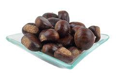 Bowl with chestnuts Stock Image