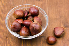 Bowl with chestnuts on wood Stock Photo