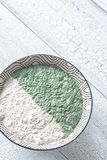 Bowl of chia seed and spirulina pudding royalty free stock image