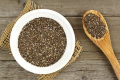 Bowl of chia seeds on wood with spoon Royalty Free Stock Photos