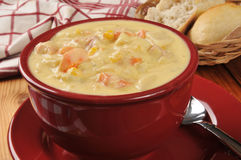 Bowl of chicken corn chowder. A bowl of chicken corn chowder with dinner rolls Royalty Free Stock Photography