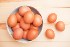 Bowl of chicken eggs. Bowl of raw chicken eggs on wooden table Stock Photos