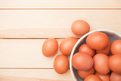 Bowl of chicken eggs. Bowl of raw chicken eggs on wooden table Stock Photo