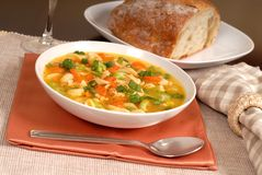 Bowl of chicken noodle soup with rustic bread Royalty Free Stock Photos