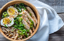 Bowl of chicken ramen soup on the wooden table Royalty Free Stock Image