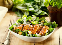 Bowl of chicken salad. On wooden table Royalty Free Stock Image