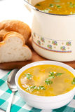 Bowl of chicken soup. Bowl and pot of chicken soup Stock Photography