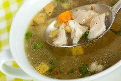 A Bowl of chicken soup with selective focus Royalty Free Stock Images