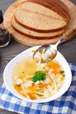Bowl of chicken soup with vegetables and noodles Royalty Free Stock Photo