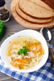 Bowl of chicken soup with vegetables and noodles Stock Photos