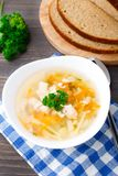Bowl of chicken soup with vegetables and noodles Stock Image