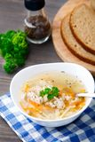 Bowl of chicken soup with vegetables and noodles Stock Photo