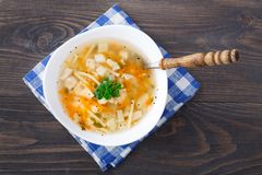 Bowl of chicken soup with vegetables and noodles Royalty Free Stock Images