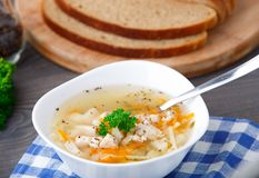 Bowl of chicken soup with vegetables and noodles Stock Images